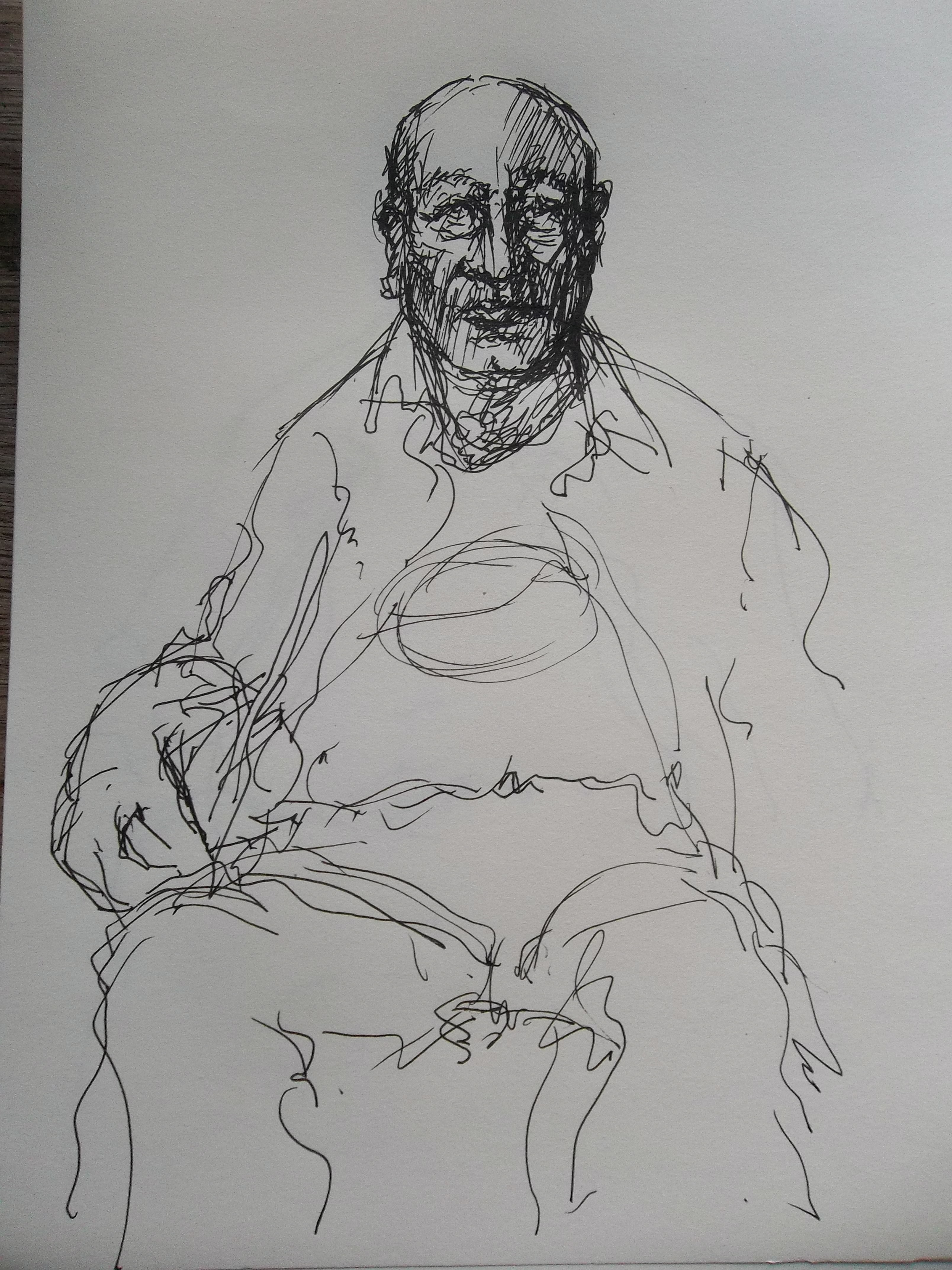 Man sitting in chair drawing - Image